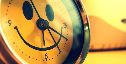 Happy Smiley Face on a Clock
