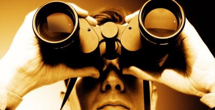 Man Looking Through Binoculars Sepia